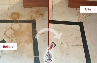 Before and After Picture of a Koreatown Hard Surface Restoration Service on a Marble Floor to Eliminate Rust Stains